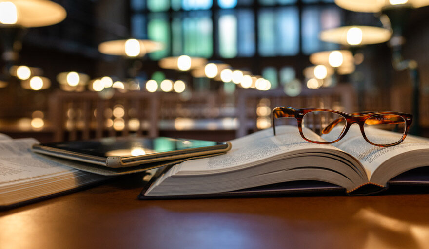 Pair of glasses sitting on top of a book