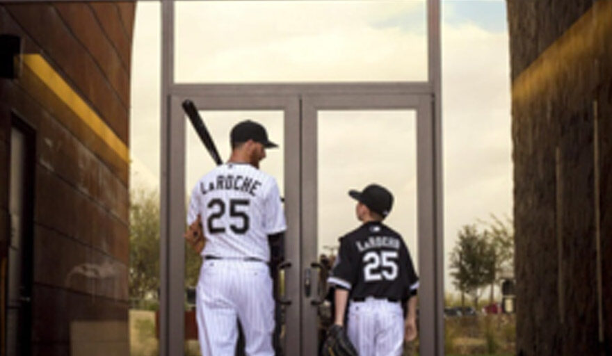 Adam LaRoche talking to a kid while walking into a building