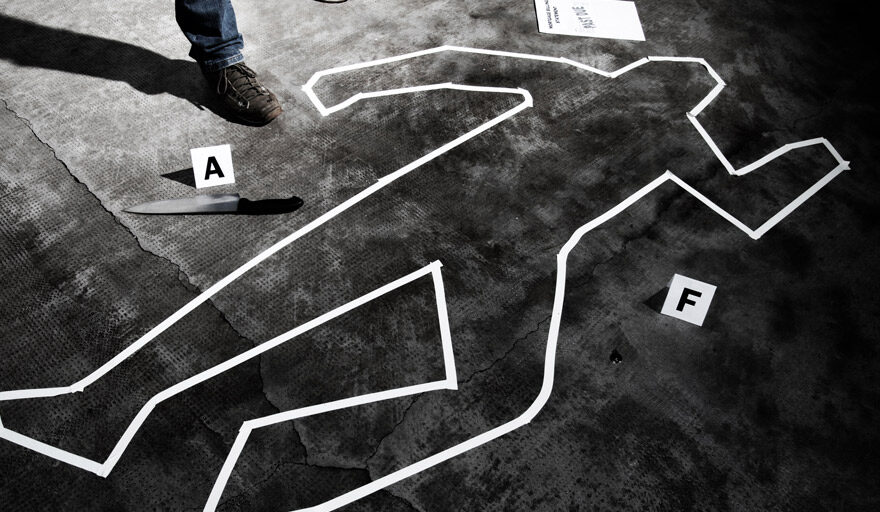 Police tape in the outline of a body
