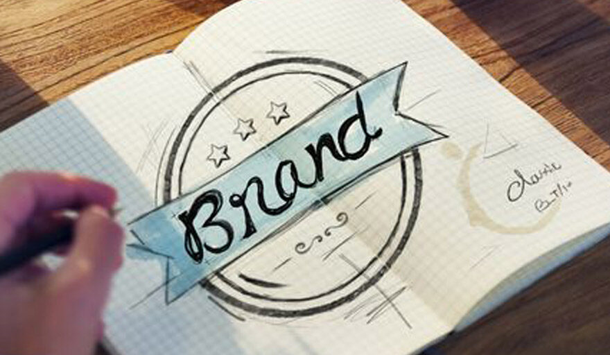 """The word """"brand"""" written in a notebook"""
