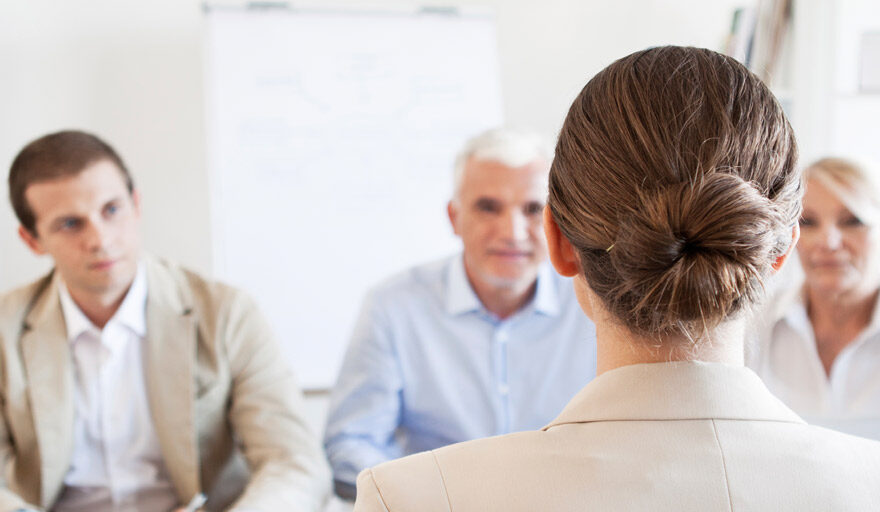 Person in a group interview setting