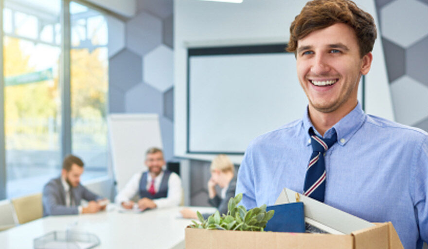 Man leaving office with his box of belongings