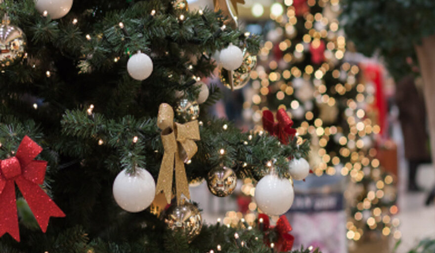 Zoomed in view of a Christmas tree with ornaments