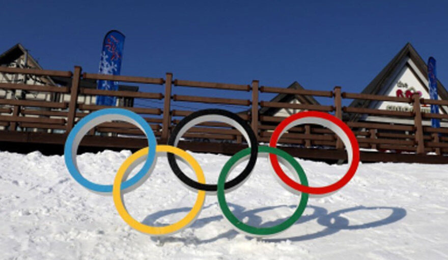 Olympic rings on top of snow