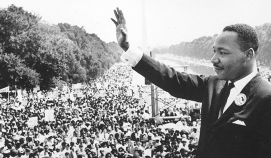 Martin Luther King waving at crowd