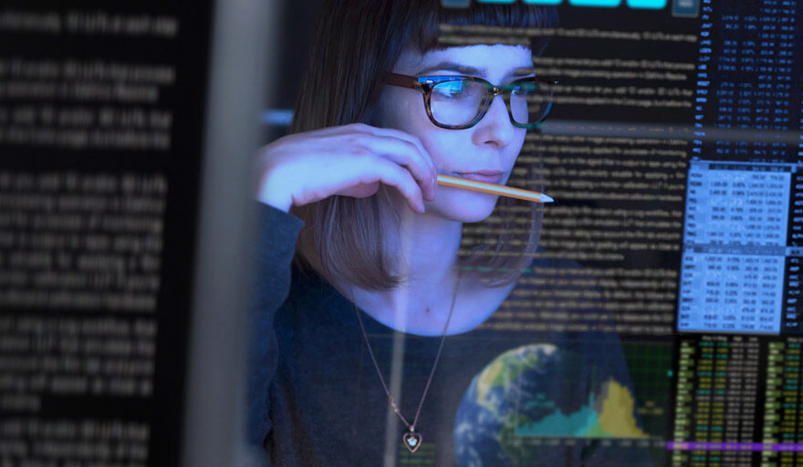 A woman working on what appears to be code