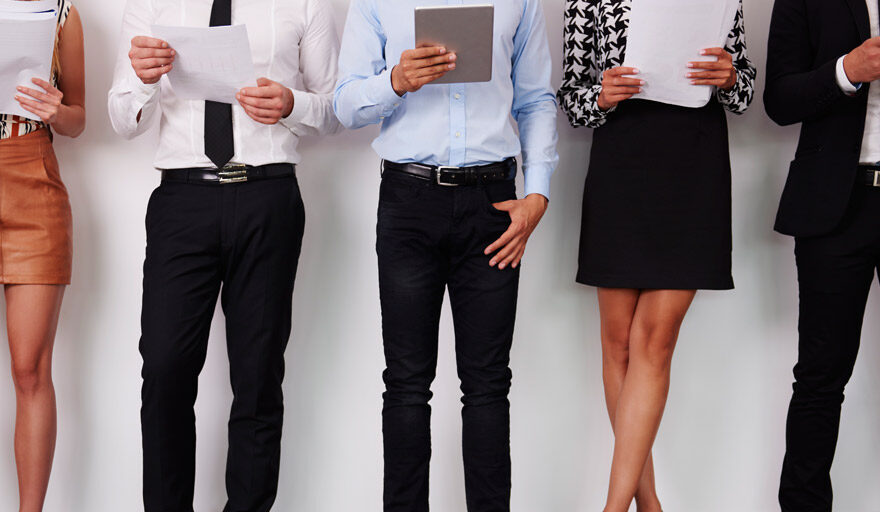 Group of job seekers standing next to each other
