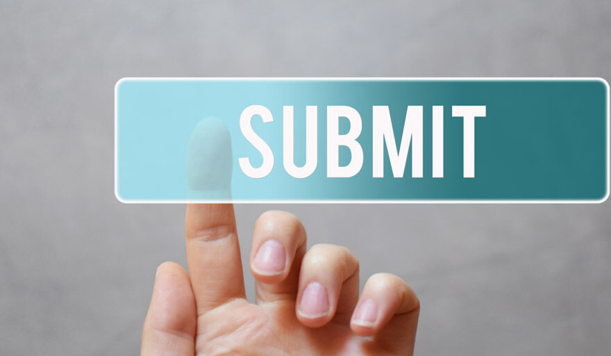 Person pressing the submit button