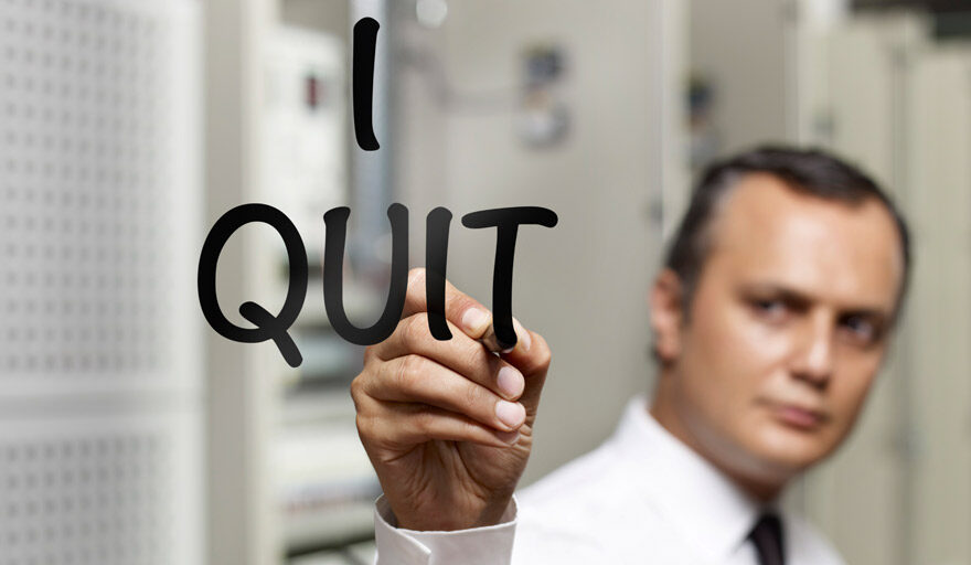 "Man writing ""I Quit"" on glass"