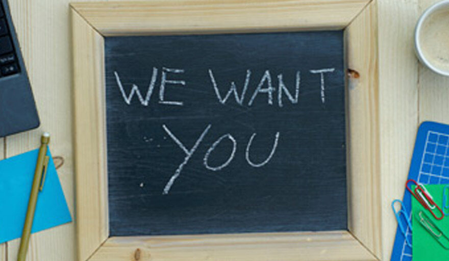 """Black board sign that reads """"We want you"""""""