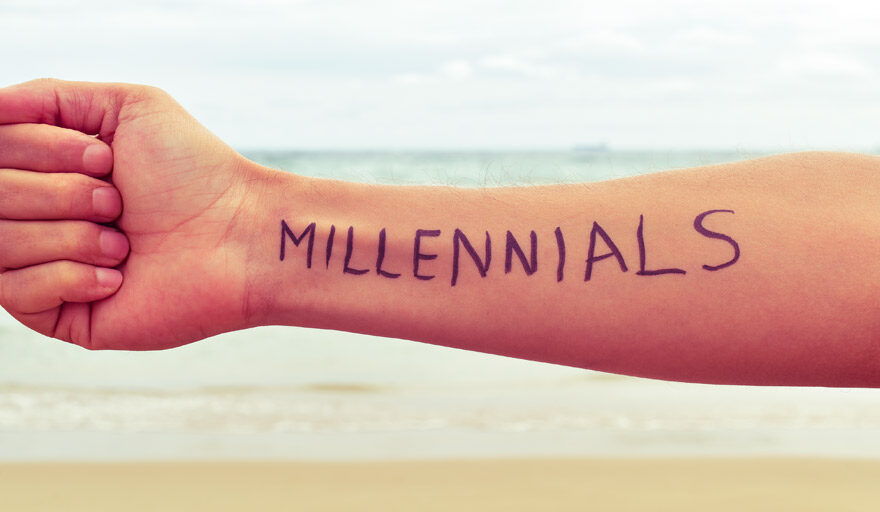 """Person holding their arm out that has """"Millennials"""" written on it"""